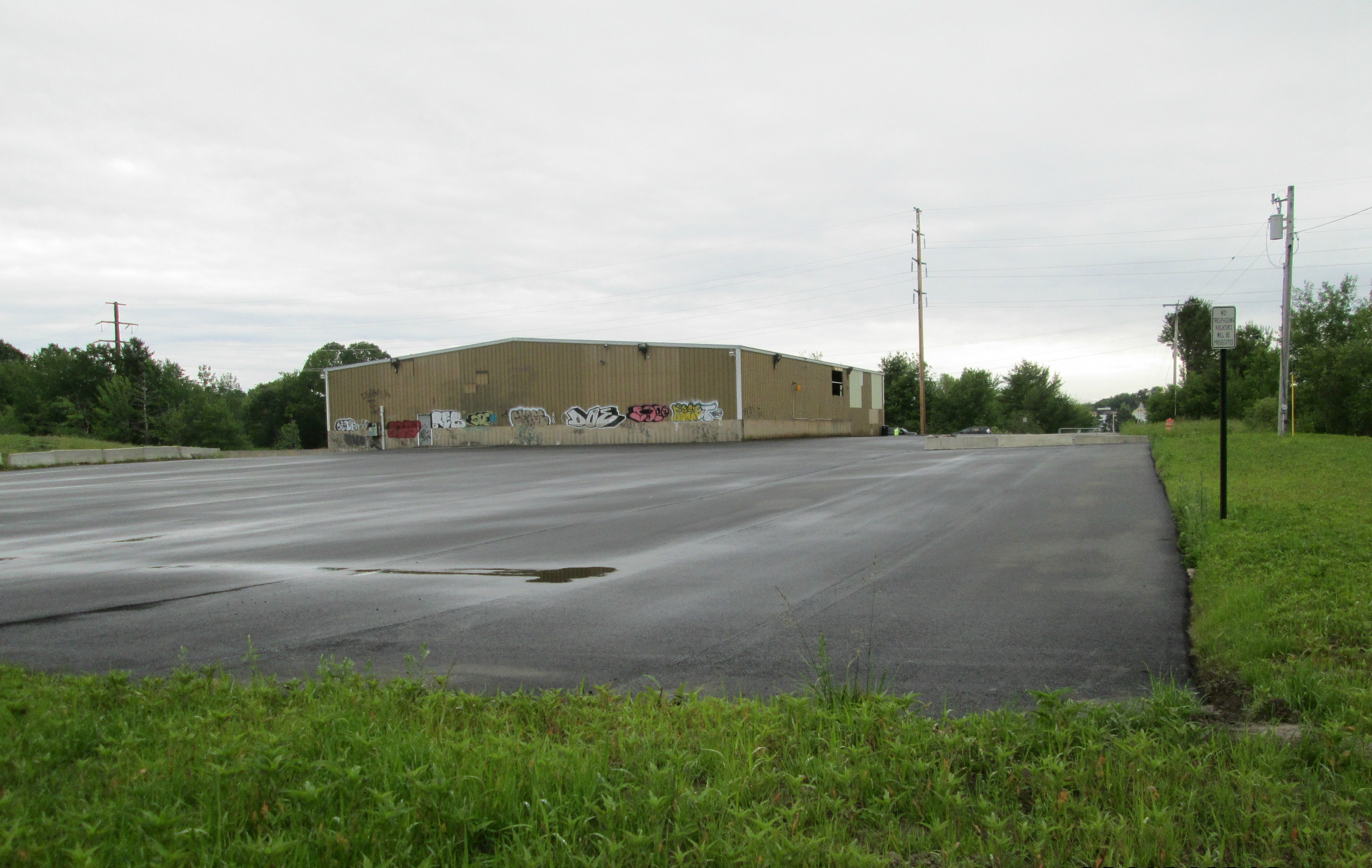 vacant industrial building and parking lot